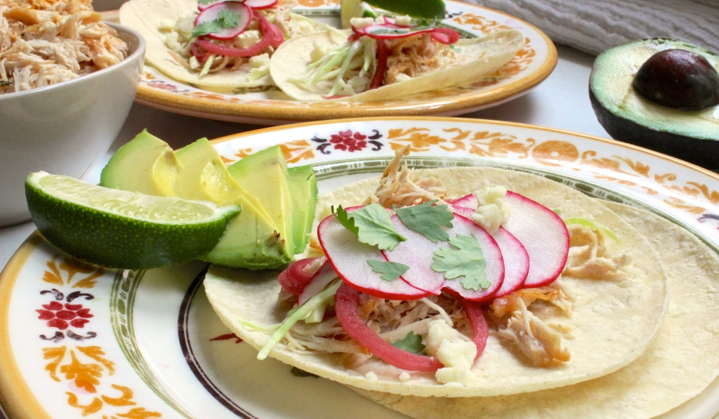 Plated chicken carnitas tacos